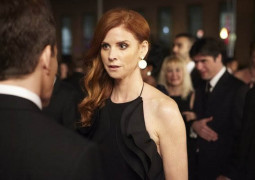 "SUITS -- ""Conflict of Interest"" Episode 304 -- Pictured: Sarah Rafferty as Donna Paulsen -- (Photo by: Ian Watson/USA Network)"